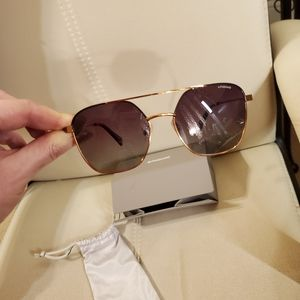 NWOT Polaroid sunglasses with case